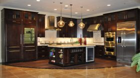 beautiful-dark-brown-wood-stainless-vintage-design-designing-kitchen-island-dark-brown-cabinet-pendant-lamp-marble-top-range-hood-refrigerator-wall-lamp-at-kitchen-with-kitchen-remodels-also-kitchen-744x419