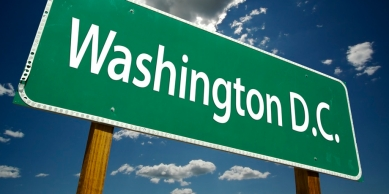 Washington D.C. Road Sign with dramatic clouds and sky.
