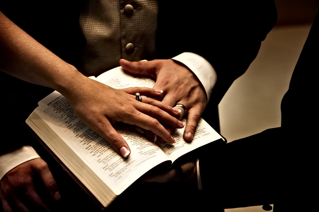 wedding-rings-hands-on-bible