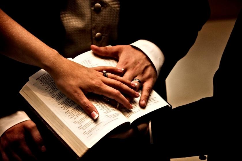 wedding-rings-hands-on-bible