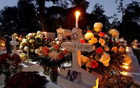 lighting-candle-and-flowers-during-all-saints-day-celebration