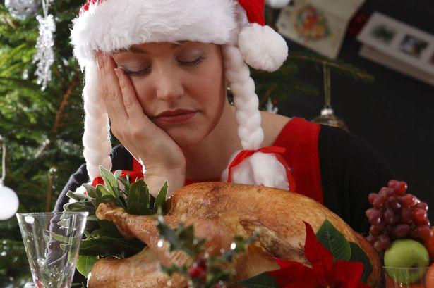 woman-asleep-with-christmas-dinner