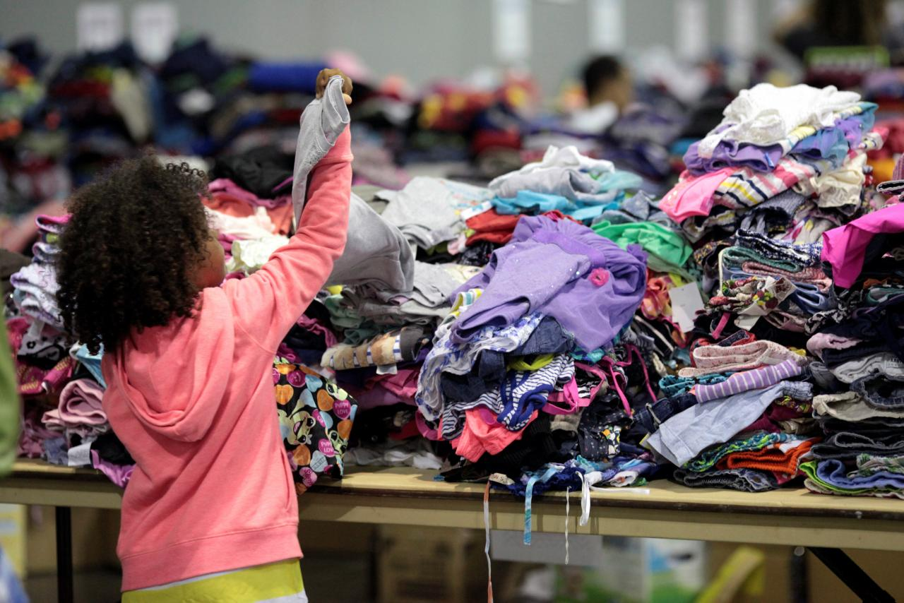 A child looks at donated clothes at a convention centre for Caribbean refugees whose homes were destroyed by Hurricane Irma, in San Juan